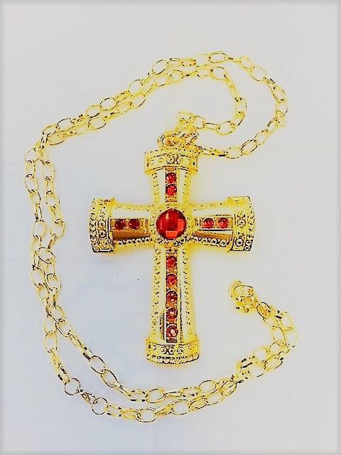Gouden kruis van Sinterklaas met rode edelsteen aan een gouden ketting