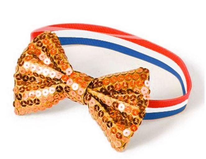 elastiek armband in rood-wit-blauw met oranje vlinderstrik